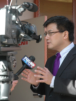 Controller John Chiang speaks to the media.